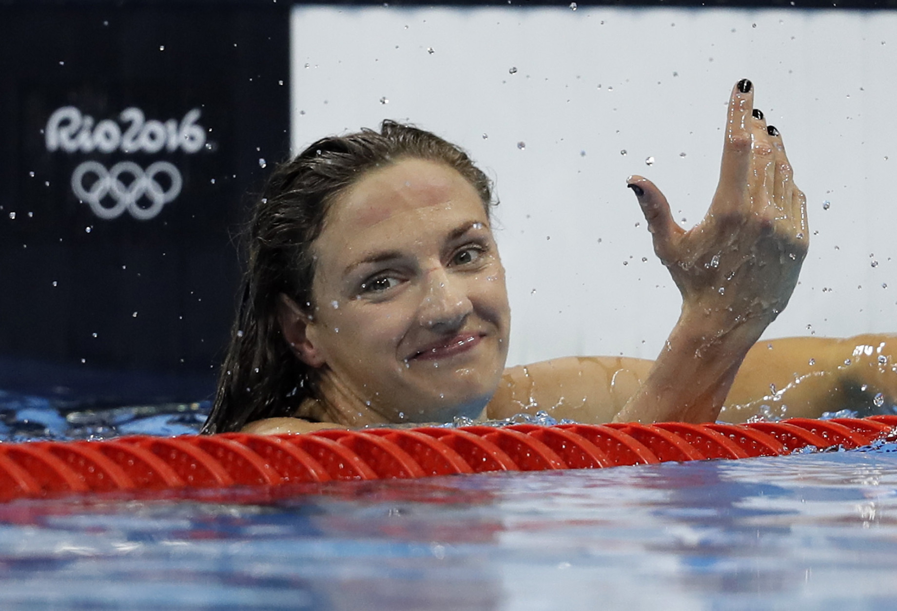 Hungary's Katinka Hosszu celebrates after winning the gold medal in the women's 100-meter backstroke final during the swimming competitions at the 2016 Summer Olympics, Monday, Aug. 8, 2016, in Rio de Janeiro, Brazil. (AP Photo/Michael Sohn)