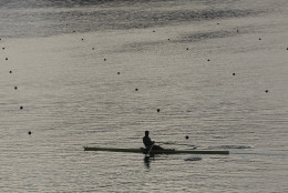 A rower practices prior to competition during the 2016 Summer Olympics in Rio de Janeiro, Brazil, Tuesday, Aug. 9, 2016. (AP Photo/Luca Bruno)