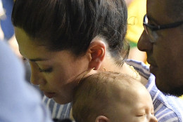 Boomer, the son of United States' Michael Phelps, sleeps on the shoulder of his mother Nicole Johnson as she leaves the hall after the men's 200-meter butterfly final during the swimming competitions at the 2016 Summer Olympics, Tuesday, Aug. 9, 2016, in Rio de Janeiro, Brazil. (AP Photo/Martin Meissner)