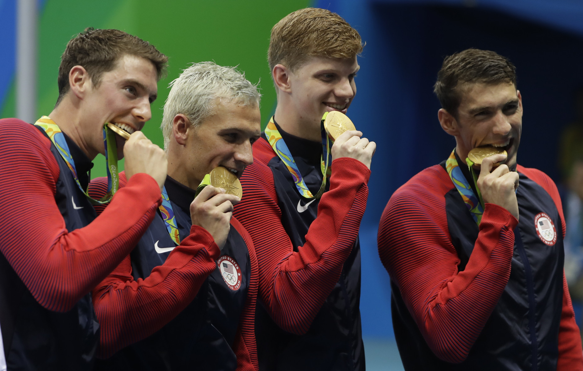 The United States team from left, Conor Dwyer, Ryan Lochte, Townley Haas and Michael Phelps celebrate with their gold medals after the men's 4x200-meter freestyle relay during the swimming competitions at the 2016 Summer Olympics, Wednesday, Aug. 10, 2016, in Rio de Janeiro, Brazil. (AP Photo/Matt Slocum)