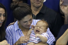 United States' Michael Phelps fiancee, Nicole Johnson, holds his baby son Boomer during the swimming competitions at the 2016 Summer Olympics, Wednesday, Aug. 10, 2016, in Rio de Janeiro, Brazil. (AP Photo/David J. Phillip )