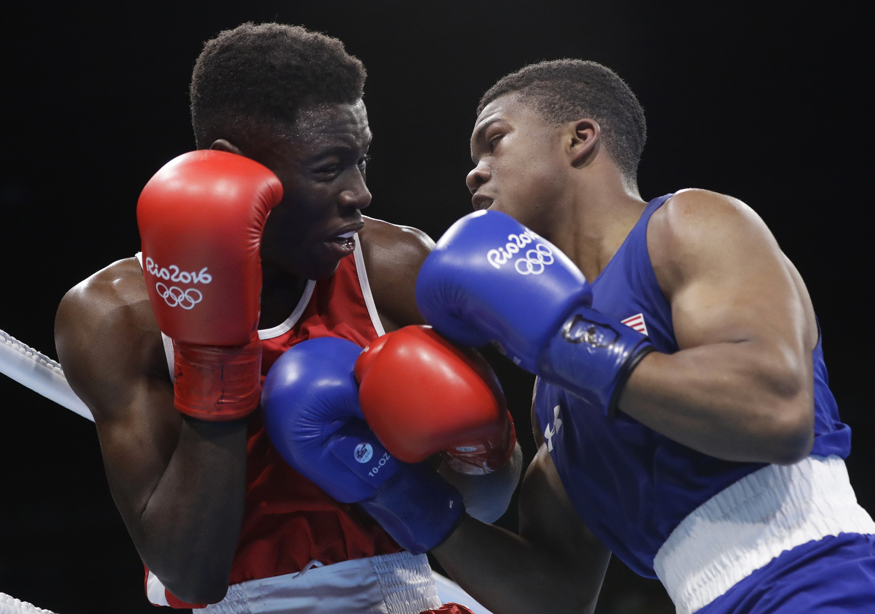 Haiti's Haiti's Richardson Hitchins, left, fights United State's Gary Russell during a men's light welterweight 64-kg preliminary boxing match at the 2016 Summer Olympics in Rio de Janeiro, Brazil, Wednesday, Aug. 10, 2016. (AP Photo/Frank Franklin II)