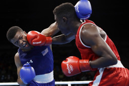 United State's Gary Russell, left, fights Haiti's Haiti's Richardson Hitchins during a men's light welterweight 64-kg preliminary boxing match at the 2016 Summer Olympics in Rio de Janeiro, Brazil, Wednesday, Aug. 10, 2016. (AP Photo/Frank Franklin II)