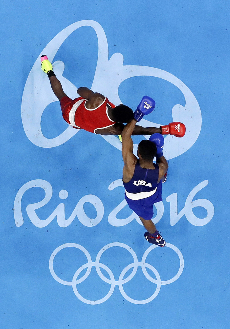 United State's Gary Russell, right, fights Haiti's Haiti's Richardson Hitchins during a men's light welterweight 64-kg preliminary boxing match at the 2016 Summer Olympics in Rio de Janeiro, Brazil, Wednesday, Aug. 10, 2016. (AP Photo/Frank Franklin II)