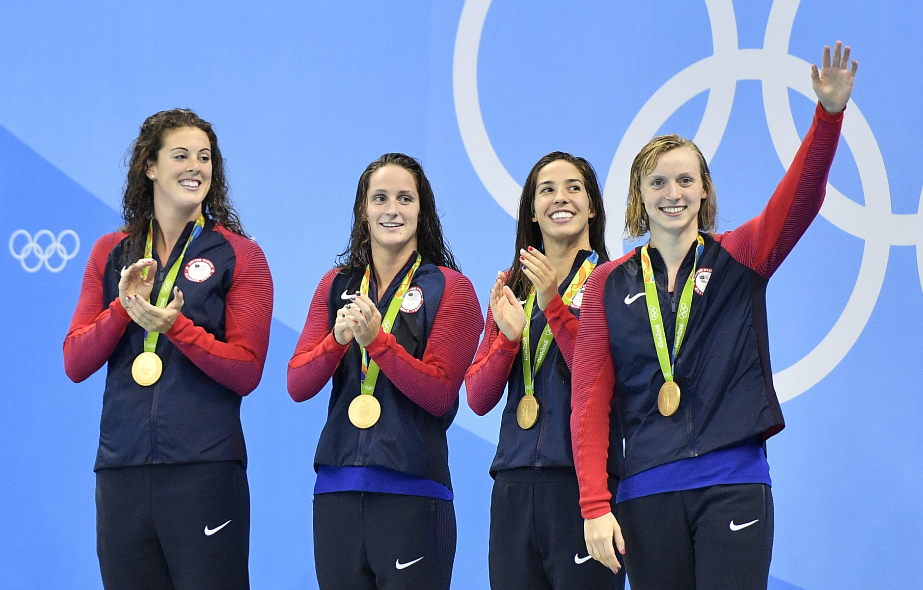 United States' Allison Schmitt, Leah Smith, Maya DiRado and Katie Ledecky, from left, celebrate their gold medals during the women's 4 x 200-meter freestyle relay medals ceremony at the swimming competitions at the 2016 Summer Olympics, Thursday, Aug. 11, 2016, in Rio de Janeiro, Brazil. (AP Photo/Martin Meissner)