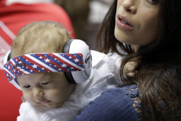 Nicole Johnson, fiance of United States' Michael Phelps, holds their baby Boomer during the swimming competitions at the 2016 Summer Olympics, Thursday, Aug. 11, 2016, in Rio de Janeiro, Brazil. (AP Photo/Natacha Pisarenko)