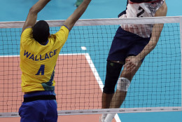 United States' Aaron Russell, right, spikes the ball over Brazil's Wallace de Souza during a men's preliminary volleyball match at the 2016 Summer Olympics in Rio de Janeiro, Brazil, Thursday, Aug. 11, 2016. (AP Photo/Jeff Roberson)