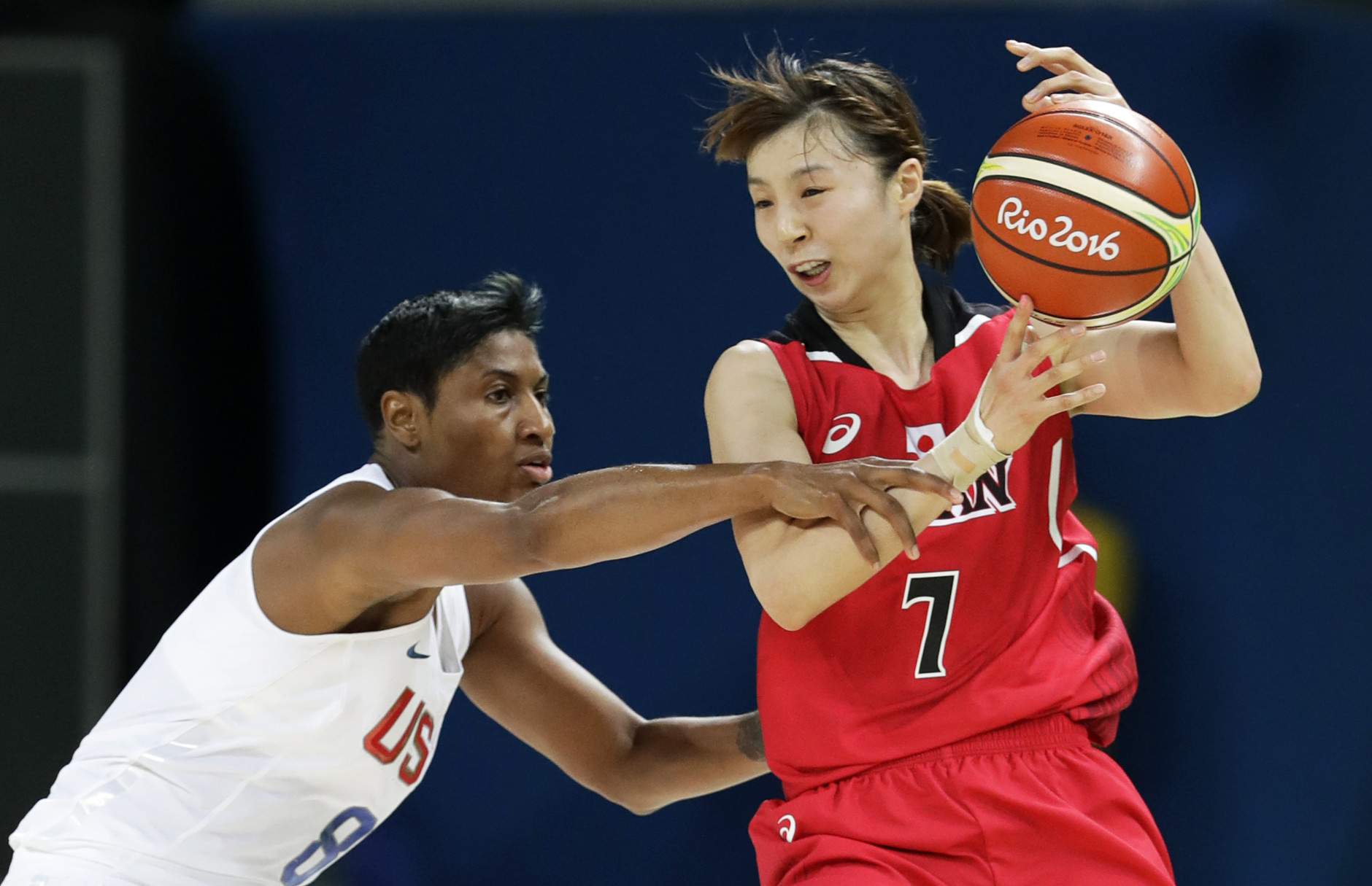 United States' Angel McCoughtry, left, tries to steal the ball from Japan's Mika Kurihara, right, during a quarterfinal round basketball game at the 2016 Summer Olympics in Rio de Janeiro, Brazil, Tuesday, Aug. 16, 2016. (AP Photo/Charlie Neibergall)