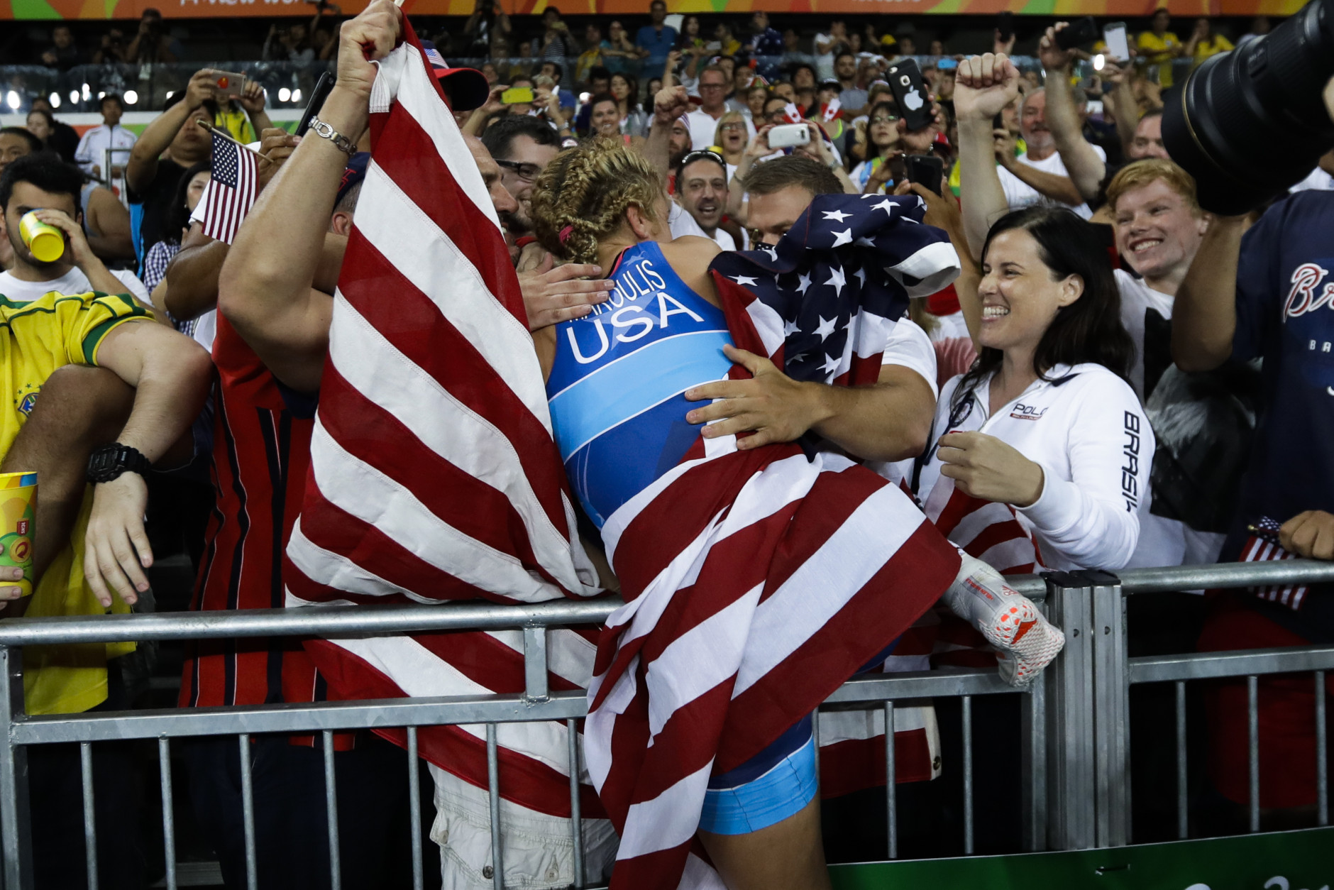 United States' Helen Louise Maroulis, centre, celebrates with fans after winning the gold medal during the women's 53-kg freestyle wrestling competition at the 2016 Summer Olympics in Rio de Janeiro, Brazil, Thursday, Aug. 18, 2016. (AP Photo/Markus Schreiber)