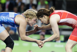 United States' Helen Louise Maroulis, blue, competes against Japan's Saori Yoshida for the gold medal of the women's 53-kg freestyle wrestling competition at the 2016 Summer Olympics in Rio de Janeiro, Brazil, Thursday, Aug. 18, 2016. (AP Photo/Markus Schreiber)