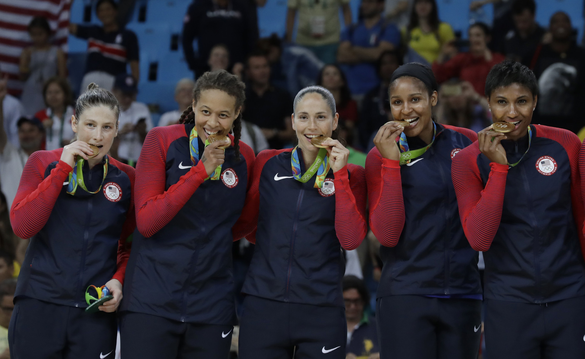 United States' Lindsay Whalen, from left, Seimone Augustus, Sue Bird, Maya Moore and Angel McCoughtry, pose with their gold medals after their win over Spain in a women's gold medal basketball game at the 2016 Summer Olympics in Rio de Janeiro, Brazil, Saturday, Aug. 20, 2016. (AP Photo/Eric Gay)