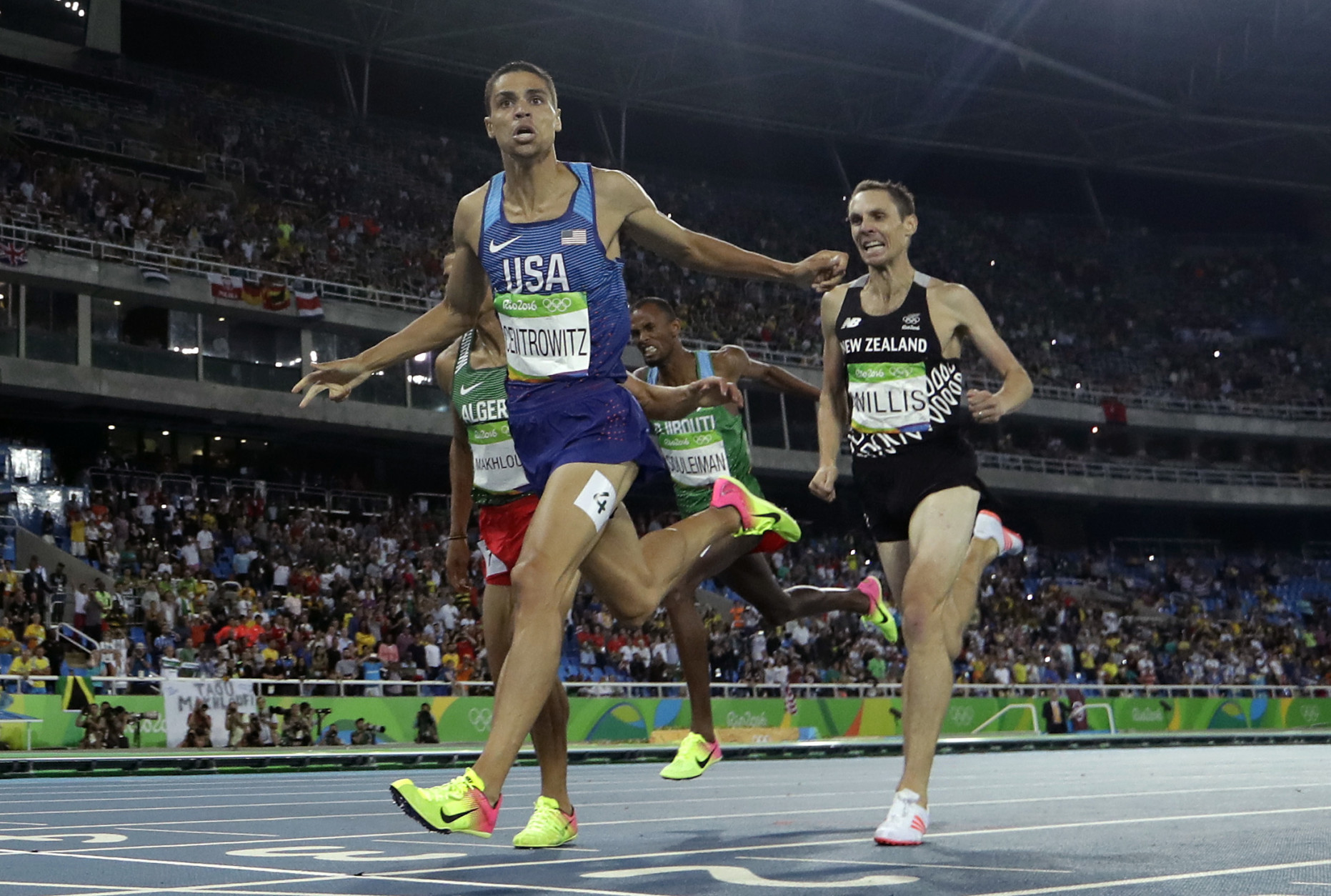 United States' Matthew Centrowitz crosses the line to win gold in the men's 1500-meter final during the athletics competitions of the 2016 Summer Olympics at the Olympic stadium in Rio de Janeiro, Brazil, Saturday, Aug. 20, 2016. (AP Photo/Matt Slocum)