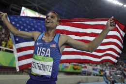 United States' Matthew Centrowitz celebrates after winning the gold medal in the men's 1500-meter final during the athletics competitions of the 2016 Summer Olympics at the Olympic stadium in Rio de Janeiro, Brazil, Saturday, Aug. 20, 2016. (AP Photo/Matt Slocum)