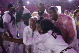Athletes from the United States pose for a photo with Simone Biles during the closing ceremony in the Maracana stadium at the 2016 Summer Olympics in Rio de Janeiro, Brazil, Sunday, Aug. 21, 2016. (AP Photo/Matt Dunham)