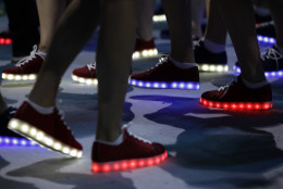 British athletes wear glooming shoes during the closing ceremony in the Maracana stadium at the 2016 Summer Olympics in Rio de Janeiro, Brazil, Sunday, Aug. 21, 2016. (AP Photo/David Goldman)