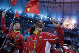 Athletes from China march in during the closing ceremony in the Maracana stadium at the 2016 Summer Olympics in Rio de Janeiro, Brazil, Sunday, Aug. 21, 2016. (AP Photo/David Goldman)