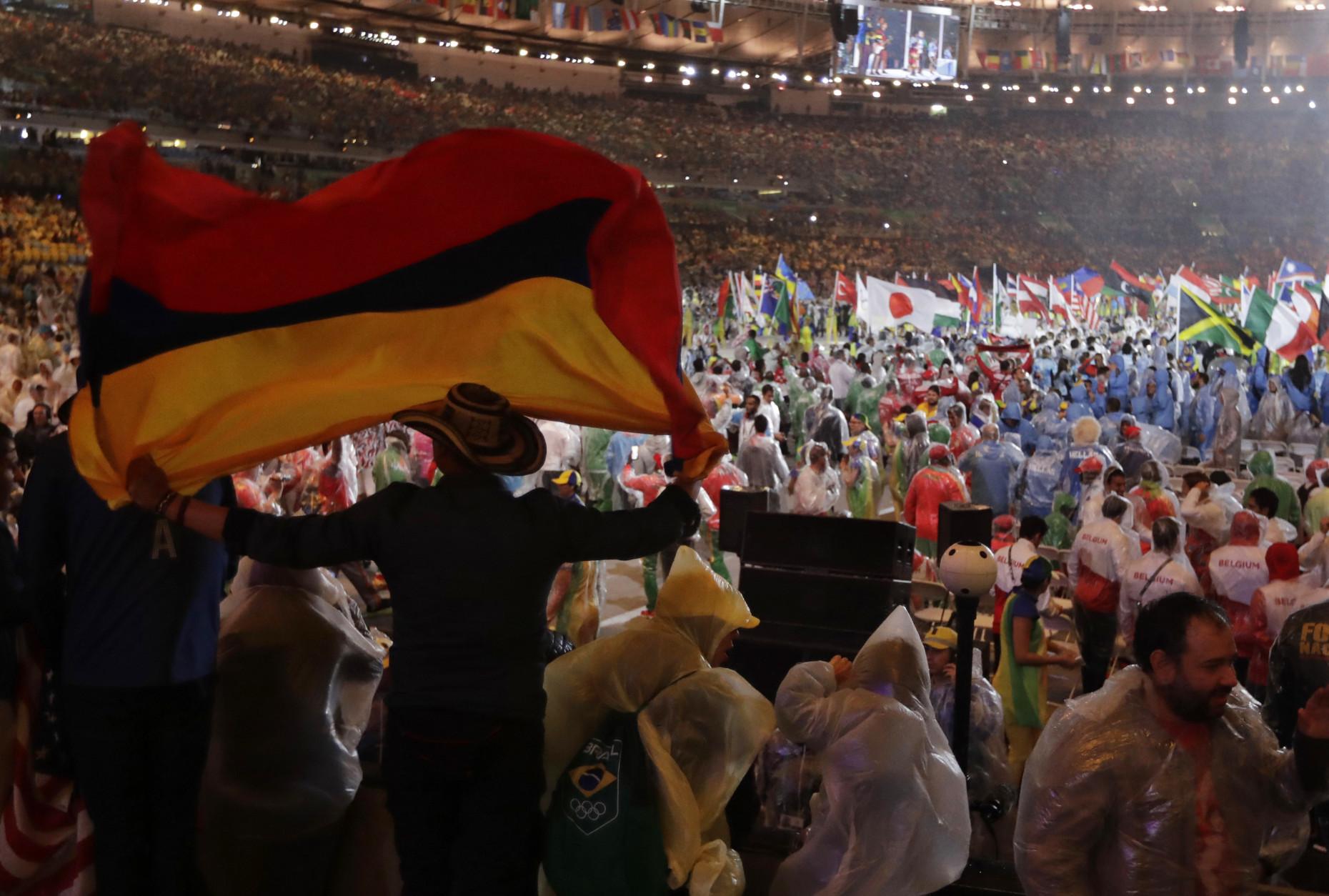 A man waves Colombia's flag during the closing ceremony for the Summer Olympics inside Maracana stadium in Rio de Janeiro, Brazil, Sunday, Aug. 21, 2016. (AP Photo/Jae C. Hong)