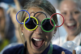 Jackie Briggs from the United States wears the Olympic ring sunglasses during the closing ceremony in the Maracana stadium at the 2016 Summer Olympics in Rio de Janeiro, Brazil, Sunday, Aug. 21, 2016. (AP Photo/David Goldman)