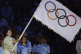 Tokyo governor Yuriko Koike waves the Olympic flag during the closing ceremony in the Maracana stadium at the 2016 Summer Olympics in Rio de Janeiro, Brazil, Sunday, Aug. 21, 2016. (AP Photo/Matt Dunham)