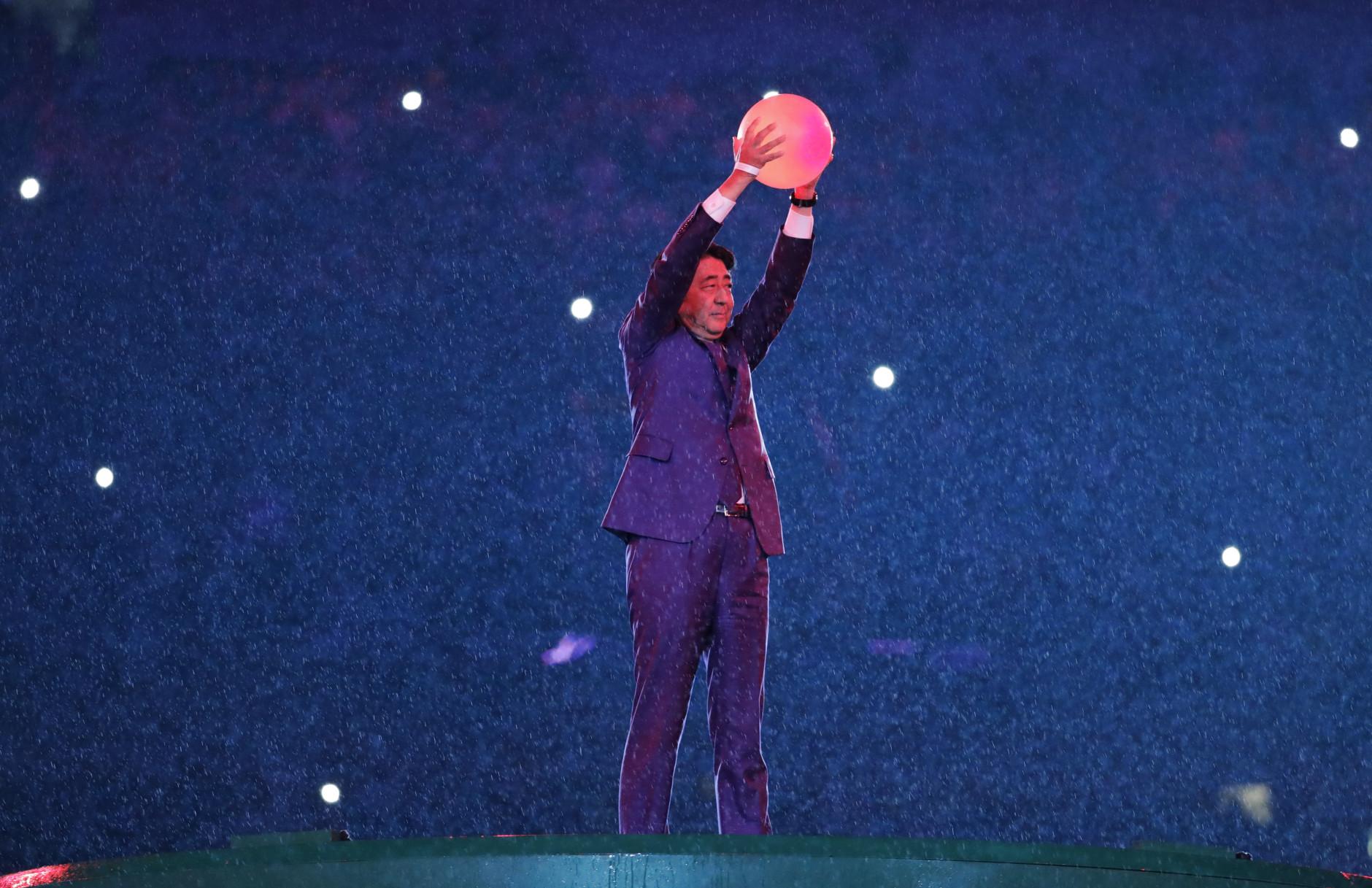 Japanese Prime Minister Shinzo Abe appears during the closing ceremony in the Maracana stadium at the 2016 Summer Olympics in Rio de Janeiro, Brazil, Sunday, Aug. 21, 2016. (AP Photo/Matt Dunham)
