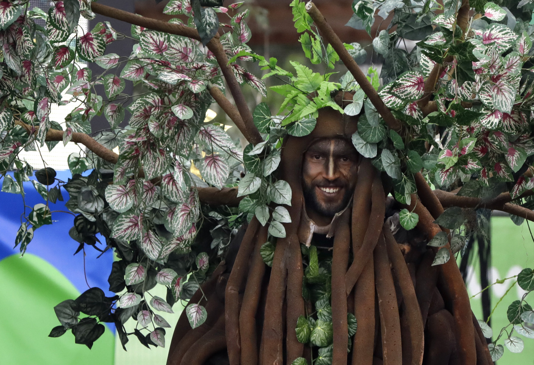 A performer is outfitted as a tree during a welcoming ceremony for Athletes at the 2016 Summer Olympics in Rio de Janeiro, Brazil, Wednesday, Aug. 3, 2016. (AP Photo/Robert F. Bukaty)