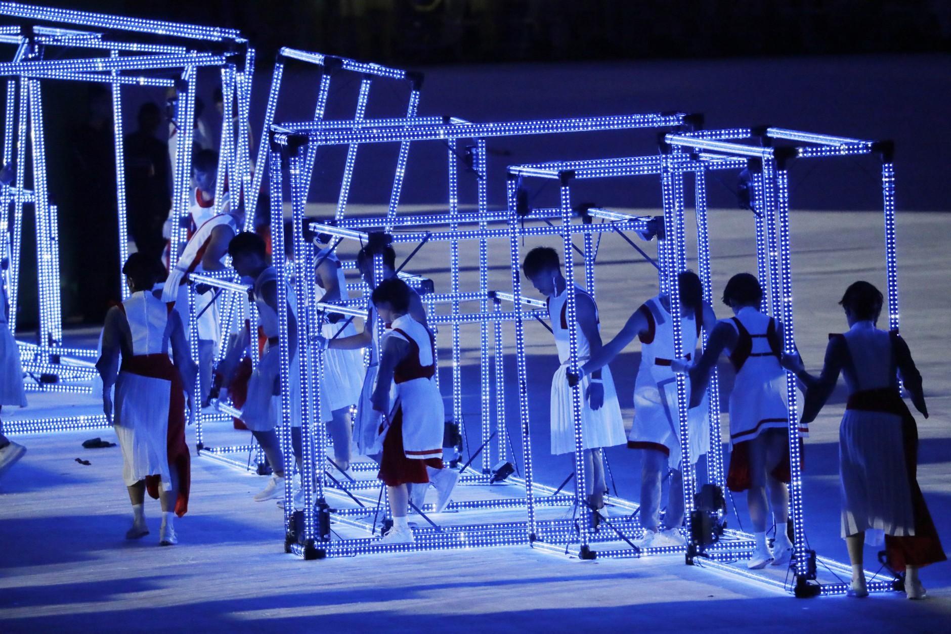 Performers maneuver near light cubes during the closing ceremony in the Maracana stadium at the 2016 Summer Olympics in Rio de Janeiro, Brazil, Sunday, Aug. 21, 2016. (AP Photo/Mark Humphrey)
