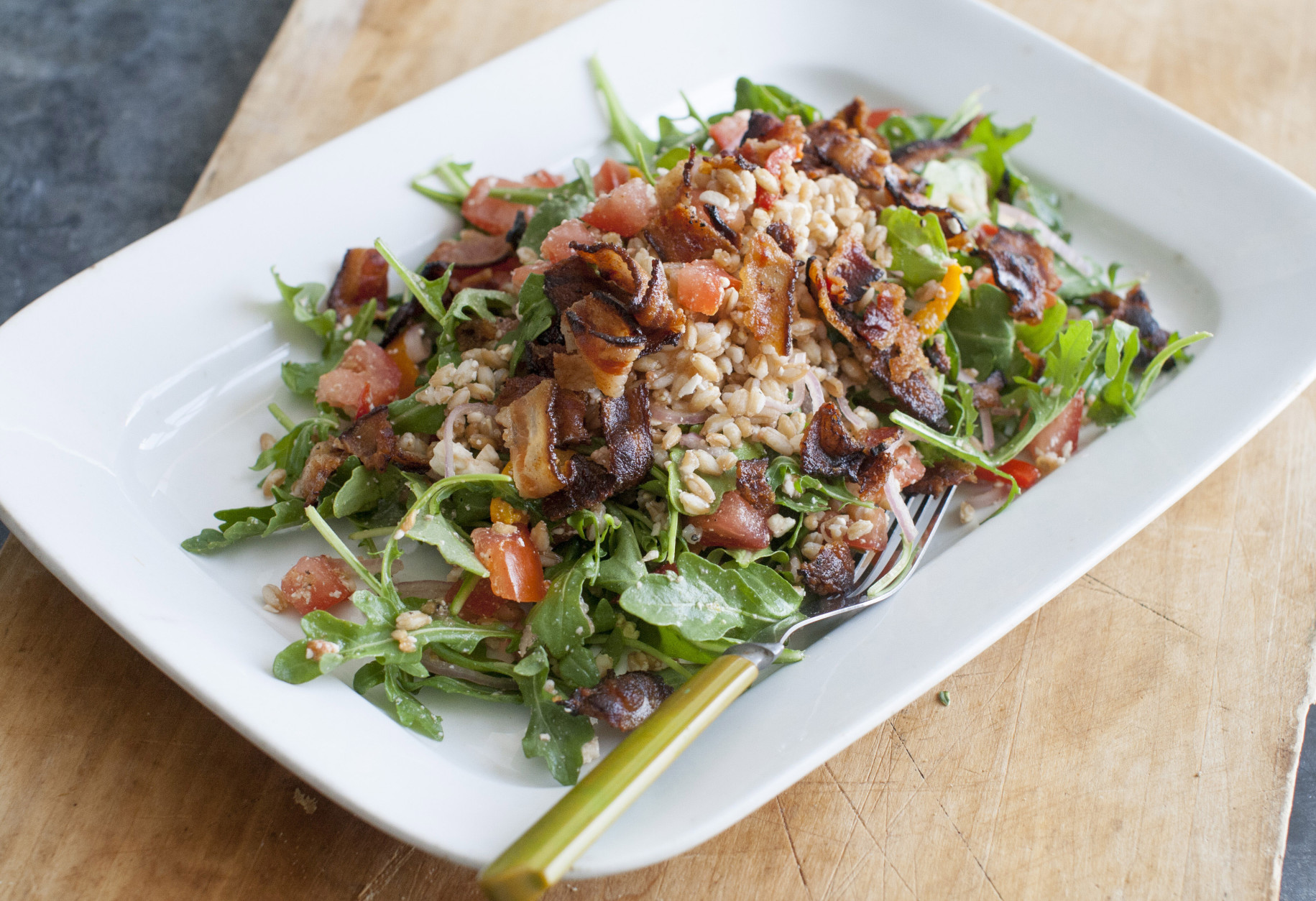 This June 30, 2014 photo shows farro and arugala salad in Concord, N.H. (AP Photo/Matthew Mead)