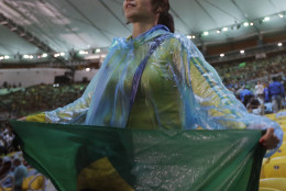 A woman holds a flag from Brazil during the closing ceremony for the Summer Olympics inside Maracana stadium in Rio de Janeiro, Brazil, Sunday, Aug. 21, 2016. (AP Photo/Jae C. Hong)