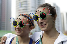 Judo competitors Angelica Delgado, of Miami, left, and Marti Malloy, of Oak Harbor, Wash., watch a welcoming ceremony at the 2016 Summer Olympics in Rio de Janeiro, Brazil, Wednesday, Aug. 3, 2016. (AP Photo/Robert F. Bukaty)
