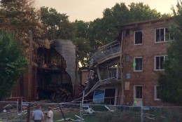 The wreckage of the FLower Branch Apartments buildings that burned and exploded on Wednesday. (WTOP/Nick Iannelli)