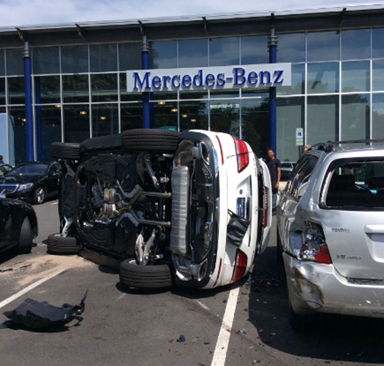A woman flipped the Mercedes SUV she was test-driving at at the Mercedes-Benz of Arlington dealership on North Glebe Road in Ballston on Friday, August 19, 2016. (Courtesy  Arlington County Fire Department).