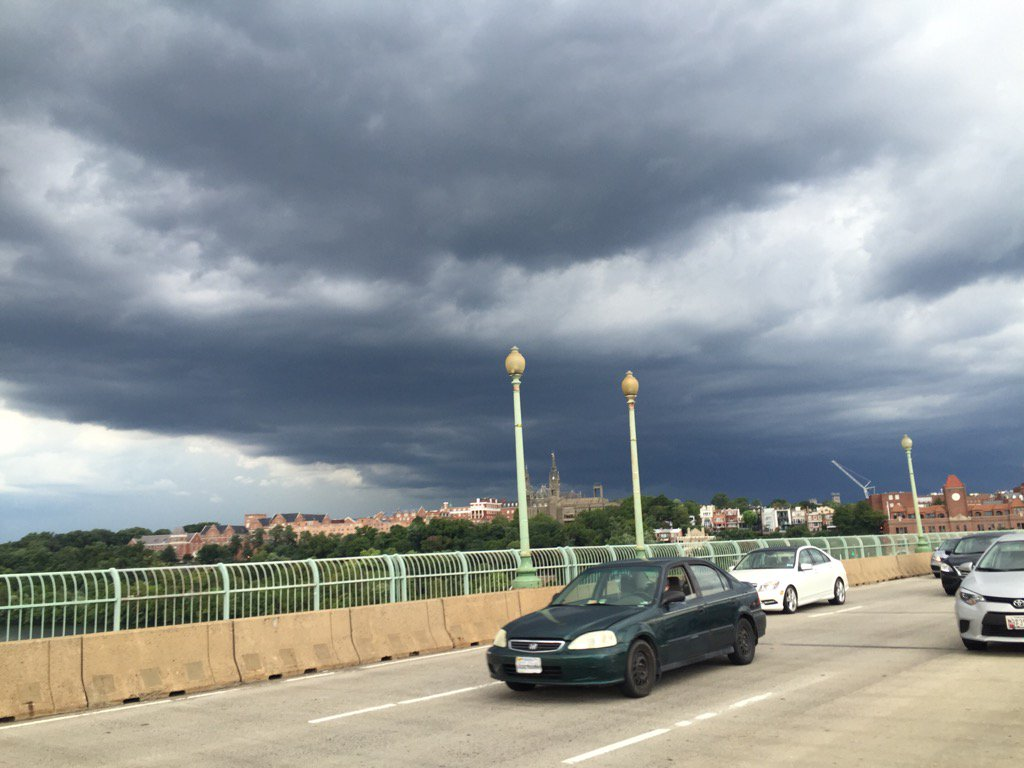 D.C. traffic: Dark clouds and lightning over Georgetown; a pretty ominous scene. (WTOP/Rob Woodfork)