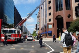 The building across the street, at 1801 L Street, was evacuated at about 10:45 a.m. (WTOP/Kathy Stewart)