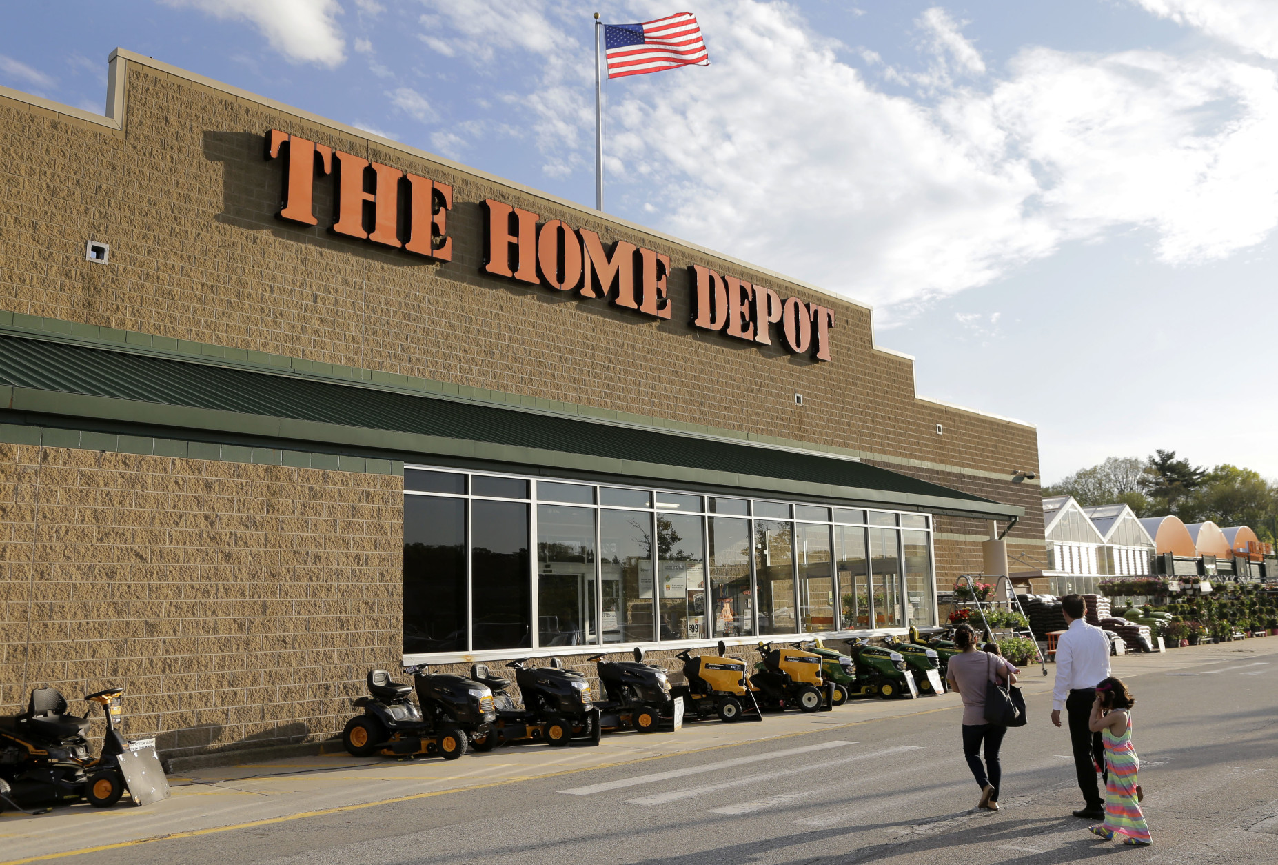 In this Wednesday, May 18, 2016, photo, people approach an entrance to a Home Depot store location in Bellingham, Mass. Home Depot reports financial results Tuesday, Aug. 16, 2016. (AP Photo/Steven Senne)