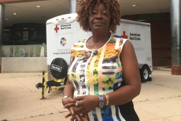 Mariama Turay stands outside Long Branch Community Center Shelter, where she has been staying since the explosion. (WTOP/Mike Murillo)