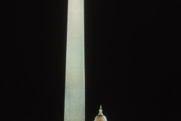 WASHINGTON - OCTOBER 01:  A general view of the Washington monument and the U.S. Capitol building illuminated at night in Wahington D.C. on October 01, 1992.  (Photo by Rick Stewart /Getty Images)