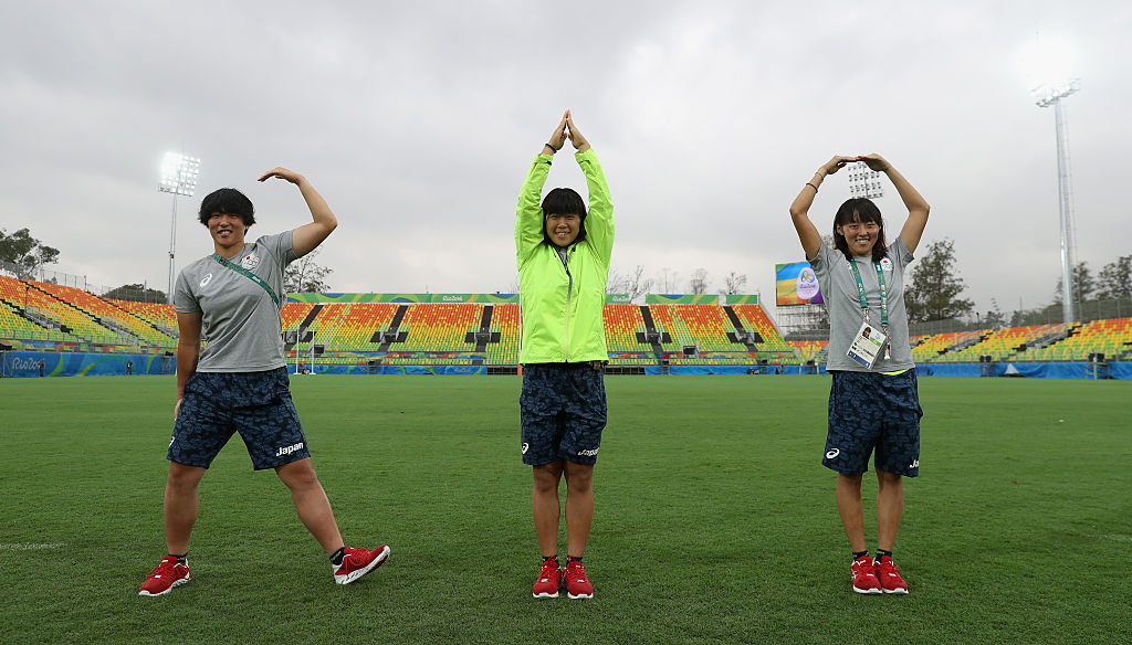 RIO DE JANEIRO, BRAZIL - AUGUST 03:  Mitsugi Kana (L), Taniguchi Noriko and Yokoo Chisato (R) of the Japan Women's rugby team spell out the word RIO as they visit the Deodora Olympic rugby stadium during the build up to the Rio Olympic Games on August 3, 2016 in Rio de Janeiro, Brazil.  (Photo by David Rogers/Getty Images)