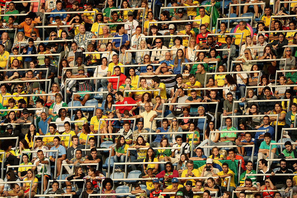 RIO DE JANEIRO, BRAZIL - AUGUST 03:  Fans look on during the Women's Group E first round match between Brazil and China PR during the Rio 2016 Olympic Games at the Olympic Stadium on August 3, 2016 in Rio de Janeiro, Brazil.  (Photo by Patrick Smith/Getty Images)