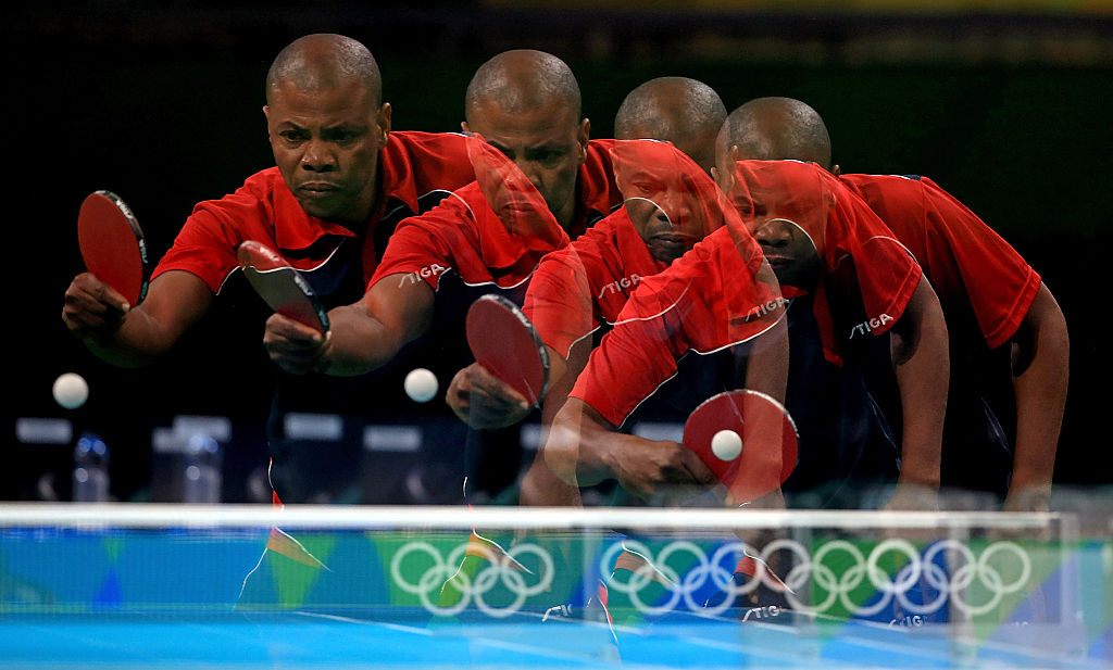 RIO DE JANEIRO, BRAZIL - AUGUST 03:  (Editors Note: Image was created using multiple exposure) Suraju Saka of the Democratic Republic of the Congo practices  during a training session for table tennis at Riocentro Pavilion 3 on August 3, 2016 in Rio de Janeiro, Brazil.  (Photo by Mike Ehrmann/Getty Images)
