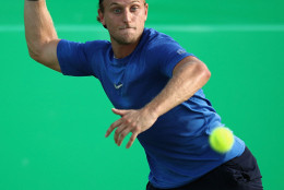 RIO DE JANEIRO, BRAZIL - AUGUST 06:  Denis Kudla of USA in action against Andrej Martin of Slovakia in the men's first round on Day 1 of the Rio 2016 Olympic Games at the Olympic Tennis Centre on August 6, 2016 in Rio de Janeiro, Brazil.  (Photo by Julian Finney/Getty Images)