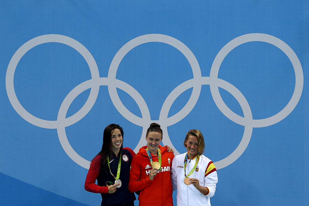 (L-R) Silver medalist Maya Dirado of the United States of America, gold medal medalist Katinka Hosszu and bronze medalist Mireia Belmonte Garcia of Spain pose during the medal ceremony for the Final of the Women's 400m Individual Medley on Day 1 of the Rio 2016 Olympic Games at the Olympic Aquatics Stadium on August 6, 2016 in Rio de Janeiro, Brazil. (Photo by Lars Baron/Getty Images)
