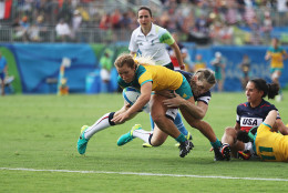 RIO DE JANEIRO, BRAZIL - AUGUST 07:  Emma Tonegato of Australia dives to score the try against Carmen Farmer of the United States during the Women's Pool A rugby match on Day 2 of the Rio 2016 Olympic Games at Deodoro Stadium on August 7, 2016 in Rio de Janeiro, Brazil.  (Photo by David Rogers/Getty Images)