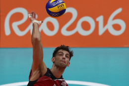 RIO DE JANEIRO, BRAZIL - AUGUST 09:  Aaron Russell of the United States spikes the ball during the men's qualifying volleyball match between the United States and Italy on Day 4 of the Rio 2016 Olympic Games at the Maracanazinho on August 9, 2016 in Rio de Janeiro, Brazil.  (Photo by Buda Mendes/Getty Images)