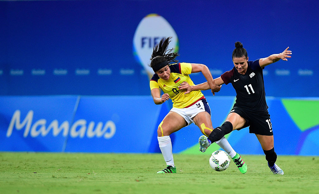 MANAUS, AMAZONAS - AUGUST 09:  Orianica Velasquez #9 of Colombia and Ali Krieger #11 of the United States vie for the ball in the second half of the Women's Football First Round Group G match on Day 4 of the Rio 2016 Olympic Games at Amazonia Arena on August 9, 2016 in Rio de Janeiro, Brazil.  (Photo by Bruno Zanardo/Getty Images)