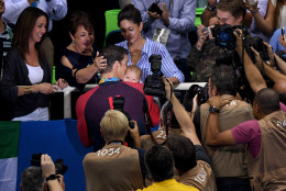 RIO DE JANEIRO, BRAZIL - AUGUST 09:  Gold medalist Michael Phelps of the United States celebrates with his mother Deborah Phelps, fiancee Nicole Johnson and son Boomer during the medal ceremony for the Men's 200m Butterfly Final on Day 4 of the Rio 2016 Olympic Games at the Olympic Aquatics Stadium on August 9, 2016 in Rio de Janeiro, Brazil.  (Photo by David Ramos/Getty Images)