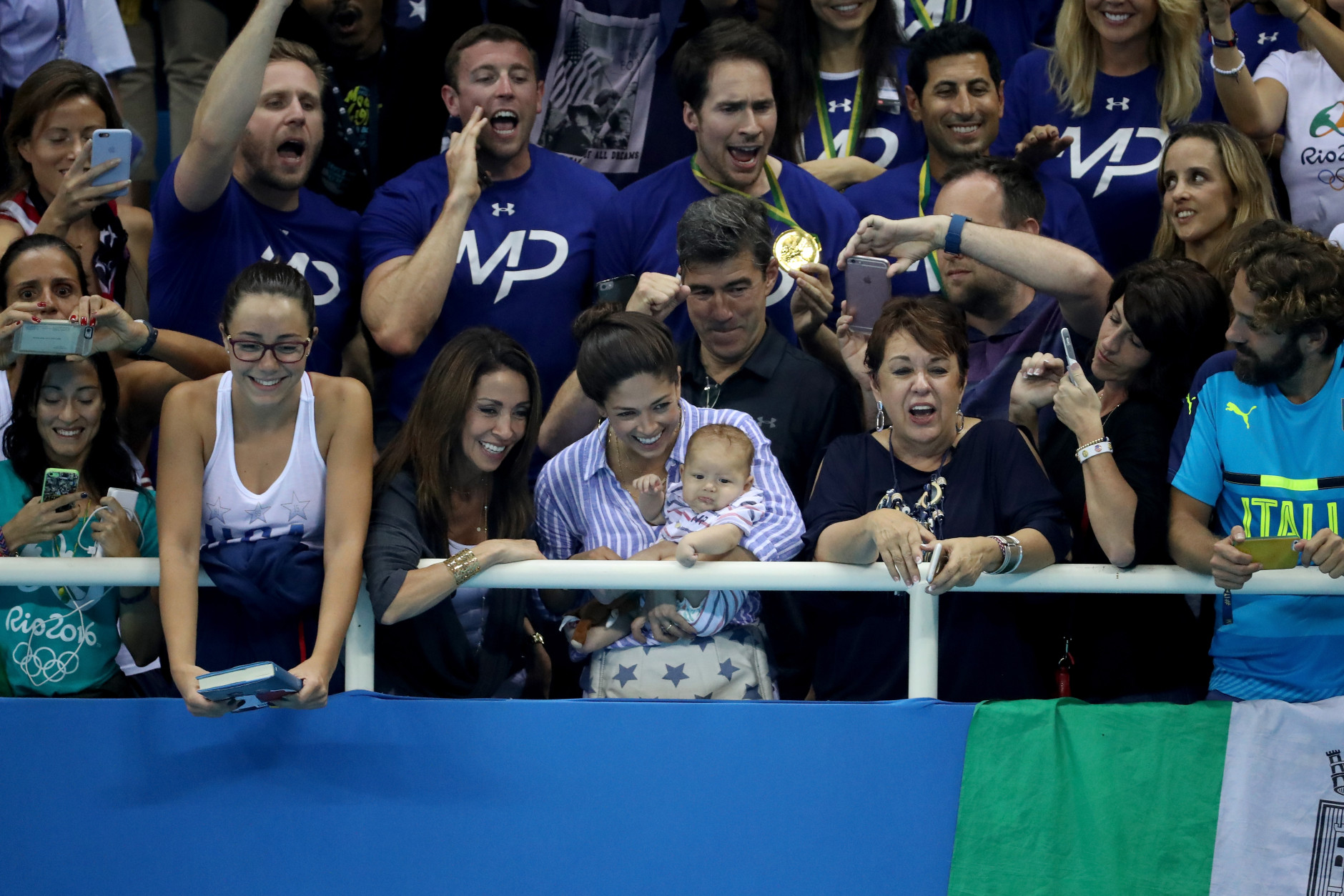RIO DE JANEIRO, BRAZIL - AUGUST 09:  The mother of Michael Phelps of the United States, Deborah Phelps, partner Nicole Johnson and their son Boomer, celebrate the gold medal victory in the Men's 200m Butterfly Final on Day 4 of the Rio 2016 Olympic Games at the Olympic Aquatics Stadium on August 9, 2016 in Rio de Janeiro, Brazil.  (Photo by Al Bello/Getty Images)