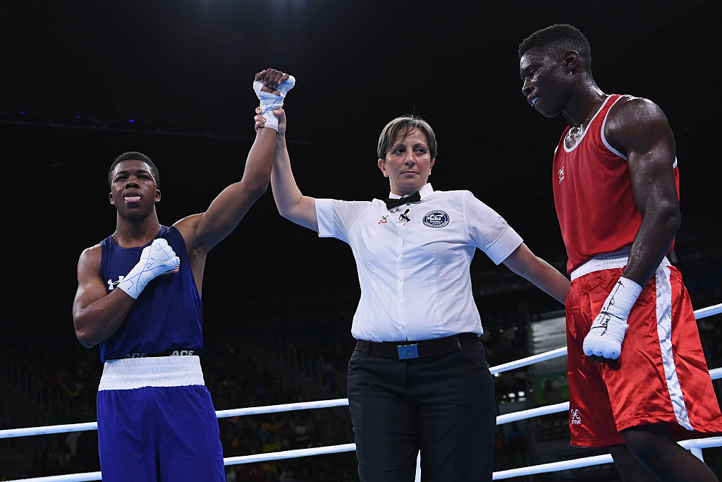 RIO DE JANEIRO, BRAZIL - AUGUST 10:  Gary Russell of United States (Blue) celebrates defeating Richardson Hitchins of Haiti (Red) in the Men's Light Welter preliminary round fight on Day 5 of the Rio 2016 Olympic Games at Riocentro - Pavilion 6 on August 10, 2016 in Rio de Janeiro, Brazil.  (Photo by David Ramos/Getty Images)
