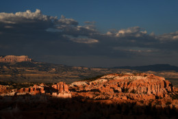 BRYCE CANYON NATIONAL PARK, UT - AUGUST 12:  Bristlecone Point is illuminated by the setting sun above hoodoos viewed from Sunset Point overlooking Bryce Amphitheater on August 12, 2016 in Bryce Canyon National Park, Utah.  (Photo by Ethan Miller/Getty Images)