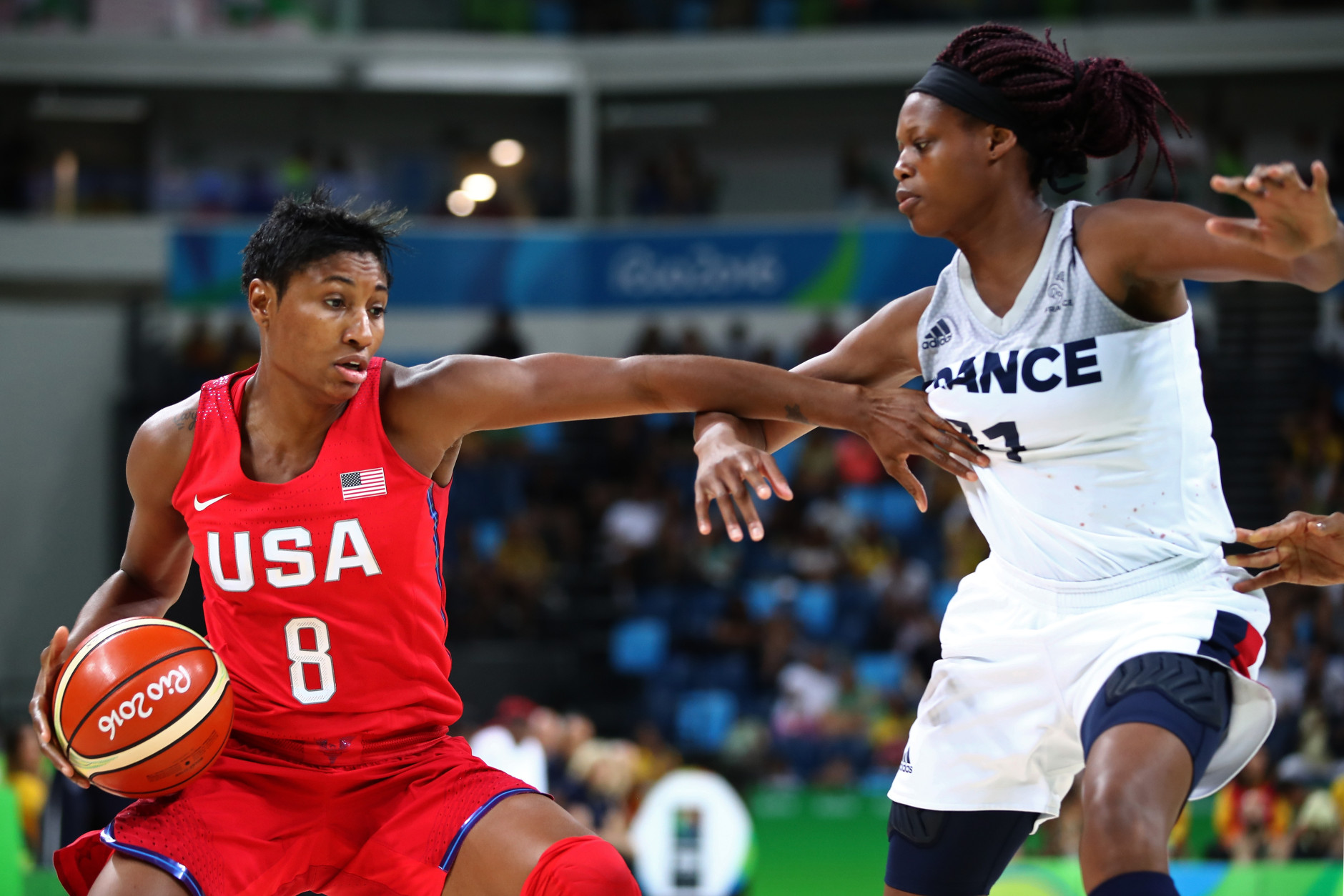 RIO DE JANEIRO, BRAZIL - AUGUST 18:  Angel Mccoughtry #8 of the United States moves the ball against Laetitia Kamba #21 of France during a Women's Semifinal Basketball game between the United States and France on Day 13 of the Rio 2016 Olympic Games at Carioca Arena 1 on August 18, 2016 in Rio de Janeiro, Brazil.  (Photo by Mark Kolbe/Getty Images)