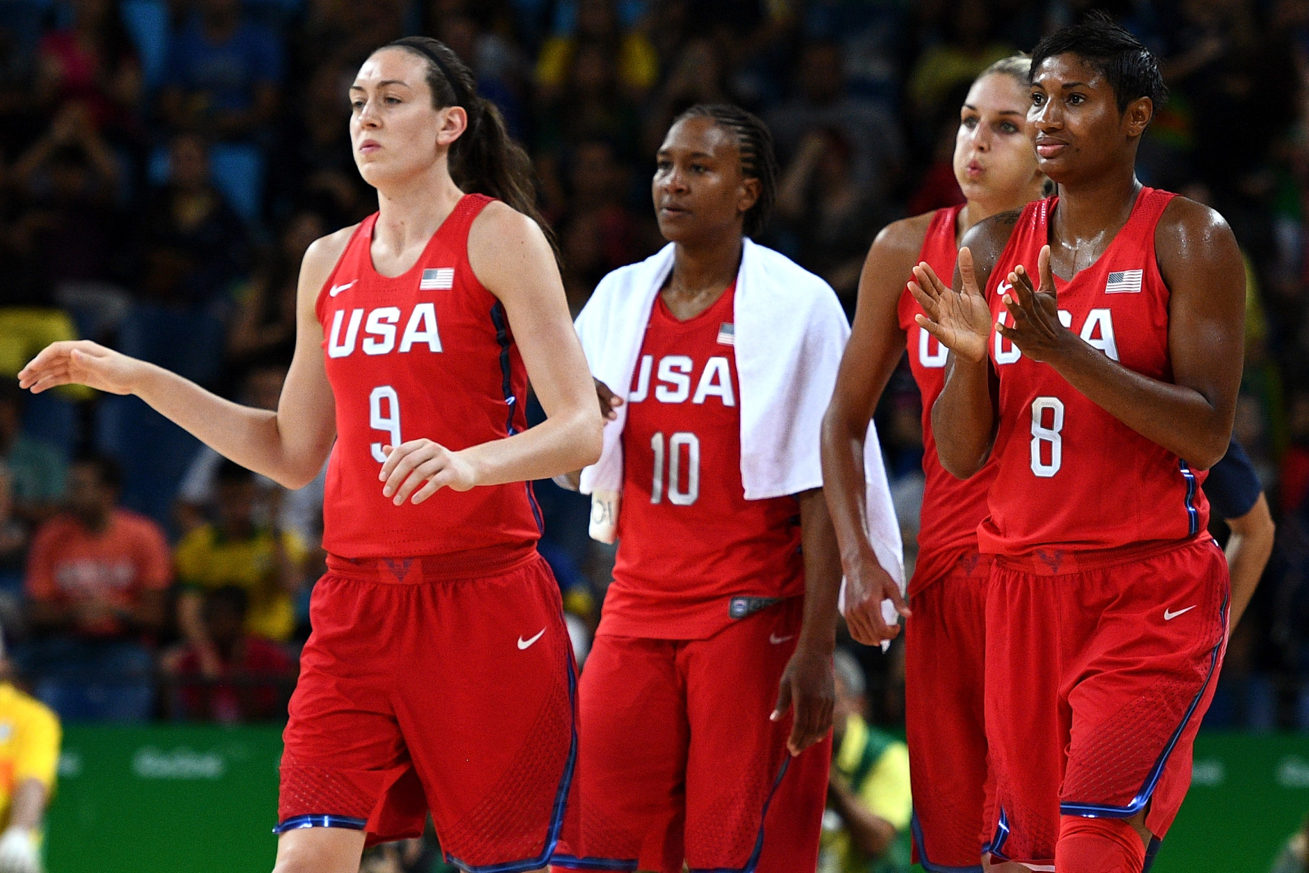 RIO DE JANEIRO, BRAZIL - AUGUST 18:  Breanna Stewart #9, Tamika Catchings #10 and Angel Mccoughtry #8 of the United States celebrate after the United States defeated France 86-67 in a Women's Semifinal Basketball game at the Carioca Arena on Day 13 of the 2016 Rio Olympic Games on August 18, 2016 in Rio de Janeiro, Brazil.  (Photo by David Ramos/Getty Images)